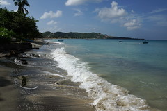 A beach in Grenada (Andy Coe) Tags: cruise blue trees sea people sun holiday hot green beach water sunshine island sand december waves ship sony dream sunny palm thomson granada caribbean alpha 2012 a77 carrabean