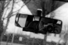 self in the car (stefpraktica) Tags: selfportrait self mirror mtl 5 150 rearview rodinal praktica fomafomapan film:iso=800 fomapan400800 film:brand=foma developer:brand=agfa agfar09oneshot film:name=fomafomapan400 developer:name=agfar09oneshot filmdev:recipe=8246