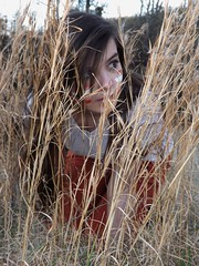 Hiding (Rachelle Harrison photography) Tags: red white girl grass dead