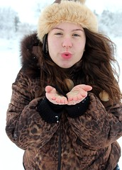 Kisses for you, you and you :* (Nataliegg) Tags: winter brown white snow cold girl beautiful hat hair kiss sweet kisses blow jacket curly cottony