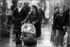 Wet, wet, wet (The Old Brit) Tags: street cold wet rain weather shopping mono december dismal market candid dreary christmasmarket raining buggy miserable southport shoppers damp merseyside marketstalls sefton babybuggy lordstreet babysbuggy