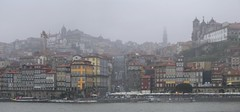 How atmospheric Porto can be in the fog (Bn) Tags: porto oporto arteaosmolhos alley raining day rain tower architectural heritage portugal bell church strolling up climbing climb capital douro river city cluttered cobbled ascending decending local markets facades harbor tourism tourist walking port wines unpretentious urban faades ambience old history characteristic symbols unesco world travel monastery sdoporto cathedral roman catholic cloister covered walk gallery decorations ceramic wisdom solomon pontelusi luizi bridge luiz electric tram domlusibridge metrodoporto rainy umbrella sandeman mist fog misty 50faves 100faves topf100