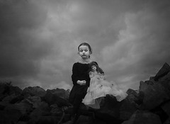 The Doll (Maren Klemp) Tags: fineartphotography fineartphotographer darkart darkartphotography blackandwhite monochrome girl kid child doll sky clouds dreamy dramatic painterly outdoors nature naturallight rocks evocative expressive ethereal portrait vintage nostalgic melancholy symbolic conceptual