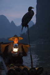 At the end of the day (ANOTHER DAY AT THE OFFICE) Tags: cormorant fisherman xingping li lijiang yangshuo river night bamboo raft guide guangxi china photographytours photography