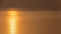 Plain and simple (AndreDiener) Tags: sunrise goldensunrise sea water early lighthouse windfree calm bay birds morning reflection ripples