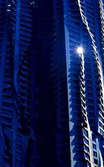 Blue Glow (pjpink) Tags: architecture frankgehry gehry skyscraper building undulating manhattan nyc newyork newyorkcity ny urban city june 2016 summer pjpink sunspot