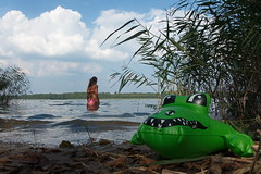 At the Lakeside (sterreich_ungern) Tags: green rubber crocodile late summer brandenburg see girl swimsuit paradise unreal kitschig macro toy water sea lake schilf pink light shadow schnappi