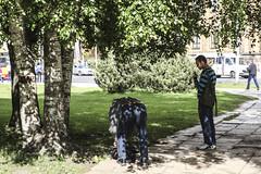 foglie (Zioluc) Tags: luciobeltrami street riga two men bent shadow trees leaves