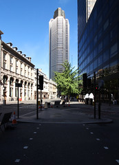 Sunny city (Kuba Skalimowski) Tags: tower42 thecity london skyscraper building architecture streetview perspective
