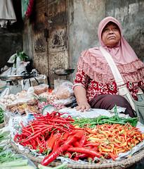 Spicy - Jakarta, Indonesia (Maria_Globetrotter) Tags: 2016 fujifilm indonesia mariaglobetrotter dscf5069 old woman street fruit vegetables indonesian capital jakarta chili fruits red yellow green peppar plump garlic