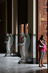 Angels at the Door (Lawrence OP) Tags: santodomingo church priory dominican quezoncity manila angels doors holywater