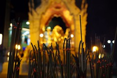 Incensed (Shane Hebzynski) Tags: incense religion ganesh bangkok gold red ash night outdoors religious lights thailand asia centralworld shrine