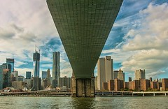 Water under the bridge (wowography.com) Tags: nyc blue autumn sky usa newyork colors skyline architecture brooklyn clouds river landscape harbor boat nikon rocks manhattan dumbo southstreetseaport brooklynbridge eastriver handheld nik hudson circleline fdr 2012 bh lightroom hss 18200mm d90 freedomtower moosepeterson 122845 mygearandme wowographycom