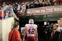 University of Wisconsin-Madison players take a tough walk off the field after losing the 2013 Rose Bowl football game, 14-20, to the Stanford University Cardinal at the Rose Bowl Stadium in Pasadena, Calif., on Jan. 1, 2013. The game is the third consecut