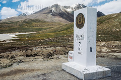 Khunjerab Pass (elevation 4,693 metres or 15,397 feet), border of Pakistan and China, Karakoram mountains (Cyrille Gibot) Tags: china road travel pakistan mountain mountains color colour horizontal landscape border pass marker xinjiang silkroad karakoram karakorumhighway jammuandkashmir khunjerab karakorum karakoramhighway