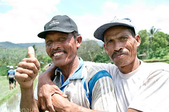 The funky brothers (tsiklonaut) Tags: travel friends portrait people bali man men tourism smile up hat indonesia workers hug asia tour close brothers pair working hats sigma class explore friendly positive southeast agriculture simple  thumbs  indonesian discover  foveon happyness  x3      dp2s balinesia tsiklonaut