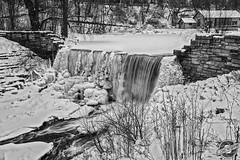 Frozen Flow (CJ Schmit) Tags: trees winter blackandwhite bw snow ice monochrome wall wisconsin creek canon waterfall pond milwaukee limestone southmilwaukee canonef1740mmf40lusm oakcreekparkway 5dmarkii canon5dmarkii cjschmit wwwcjschmitcom niksilverefex2 cjschmitphotography