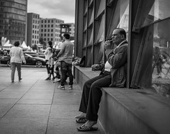 Taking a break (Bilderschachtel Photography) Tags: people monochrome blackandwhite road street life cigarette barefoot man potsdam square berlin bw candid fujifilm xt10 35mm flickr urban minimalistic outdoor break smoking city citylife