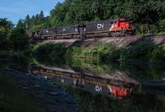 Reflecting on the Bessemer (Joseph Bishop) Tags: cn 5422 sd60 emd conneaut ohio cnbessemersubdivision trains train track tracks railfan railroad railway rail rails ic sd70