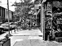 Strolling (Dennis Sparks) Tags: blackwhite michigan annarbor eastlibertystreet pedestrians strollers