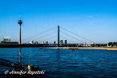 The rhine brigde (Bernsteindrache7) Tags: summer sony alpha 100 sky blue bridge water wasser weather rhine panorama heaven himmel outdoor landscape nrw germany
