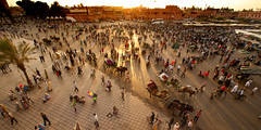 Morocco - Marrakech - Jemaa el-Fnaa - Sunset panorama (Darrell Godliman) Tags: africa travel sunset people panorama copyright view terrace northafrica widescreen balcony wideangle panoramic busy morocco maroc vista marrakech marrakesh viewpoint allrightsreserved chaotic settingsun travelphotography bustling jemaaelfnaa dgphotos darrellgodliman wwwdgphotoscouk dgodliman moroccomarrakechjemaaelfnaasunsetpanoramadsc5422 wwwfacebookcomdsgphotos