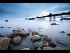 Merry Christmas Everyone (A-D-Jones) Tags: blue sun seascape water wales sunrise landscape pier still rocks long exposure tide north july milky llandudno