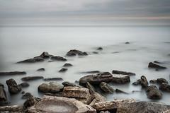 Rocky Shore (Justin Lo Photography) Tags: lake ontario canada blur water landscape landscapes rocks long exposure shore dreamy lakeontario dreamscape