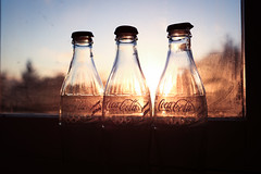 306. (Tom Joy) Tags: sunset vintage bottles drink dusk coke dirt flare cocacola glasswindow