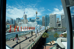 Darling Harbour from monorail (ms__) Tags: skyline architecture buildings harbor nikon harbour sydney flags darlingharbour lightrail sydneytower centrepointtower sydneyskyline monrail d7000 nikond7000