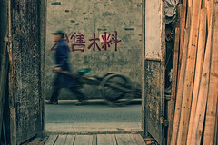 The future is not waiting (~mimo~) Tags: china street door old people man blur color writing photography alley asia shanghai chinese worker mimokhair