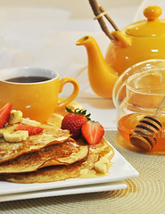 Pancakes with tea [Explored] (Bhaskar Dutta) Tags: new morning food india cup breakfast photography hotel flickr photographer tea delhi tasty explore kettle honey commercial pancake hire stirrer yahoo:yourpictures=breakfast