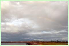 Delicatezze in cielo (RoLiXiA) Tags: sardegna sky clouds rainbow nuvole sardinia natura cielo arcobaleno cagliari sardaigne stagno zoneumide assemini nikond90 stagnodisantagilla