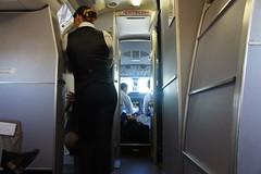Seated 2E (individual8) Tags: inflight cabin costarica january sanjose cockpit salida exit pilots flightattendant 2013