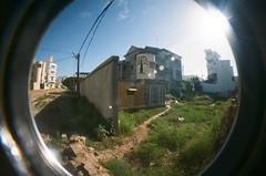 Cafe (EmperorNorton47) Tags: senegal photo analog film lomographyfisheyeno2 kodakportra400 ngor neighborhood cafe apartments