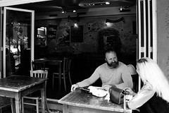 In a Caf (Gianluca De Simone) Tags: bar caf caff relax afternoon pomeriggio black white man woman couple coppia street photography berlin strada sorriso intesa smile blond beard long germany german germania