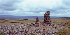 two cairns (Ron Layters) Tags: 2cairns fountainsfell cairn pennineway twocairns moorland summit rocks landscape vista yorkshiredales day10 hortoninribblesdale england unitedkingdom slidefilmthenscanned slide transparency fujichrome velvia canoneos300v canon eos300v rebelti ronlayters
