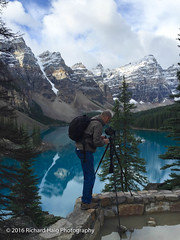 Nancy caught me in action again (RichHaig) Tags: iphone6 nancyhaig nikonnikkor1424mmf28 water reflections richhaig gitzotripod clouds banffnationalpark snow banff waterpuddle sky trees nikond800 remoterelease morainelake mountains