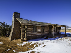 Cabin at Ghost Ranch (Mabry Campbell) Tags: 2016 february ghostranch h5d50c hasselblad mabrycampbell newmexico usa unitedstatesofamerica blue cabin commercialphotography countryside fineart fineartphotography house image landscape logcabin orange photo photograph photographer photography ranch snow winter f11 february52016 20160205campbellb0000511 24mm sec 100 hcd24