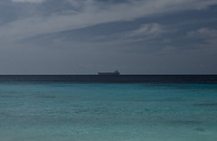 279 (kosmekosme) Tags: freighter boat water ocean horizon cloud clouds cloudy carribean beach curacao curaao blue sun sunny travel travelling euronav ship tanker vessel naval
