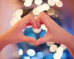Love Christmas ( Angel of light ) Tags: christmas love child hand heart bokeh saturday cliche  hcs angeloflight2009