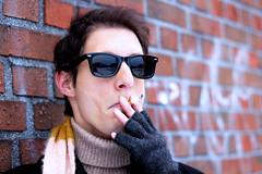 Josef (rosettflickan) Tags: winter portrait bw snow cold guy mono bokeh cigarette smoke brickwall fotosondag fs121209 fargstark
