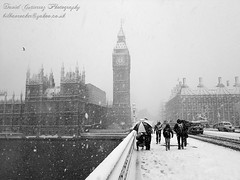 Snow in London (david gutierrez [ www.davidgutierrez.co.uk ]) Tags: christmas street city uk bridge winter light sky people urban blackandwhite bw white snow storm cold london tower art classic clock blancoynegro beautiful westminster weather architecture clouds blackwhite frost cityscape image top taxi postcard housesofparliament bigben retro wonderland iconic timeless londoncab festiveseason davidgutierrez