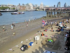 London beach (Andy Worthington) Tags: london sand skyscrapers shoreline festivals streetphotography cathedrals flags southbank waterloo rivers beaches stpaulscathedral unionjack riverthames gherkin thamesfestival se1 cityoflondon sandsculptures londonse1 southbankcentre coinstreet andyworthington
