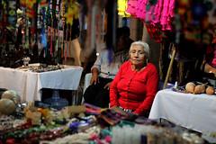 Abuela (Maya Rafie) Tags: red portrait woman 50mm market handmade jewelry mercado abuela wise handwork artisanat stphotographia