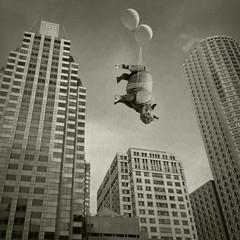 upside downtown (Janine Graf) Tags: silly 6x6 boston balloons ma downtown skyscrapers surreal officebuildings adventure financialdistrict rhino artrage whimsical airtravel traveler whiterhinoceros waitforme juxtaposer sandiegowildsafaripark janine1968 iphone4s scratchcam janinegraf snapseed damngiraffes