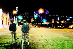Looking at the Lights (Panas Photography) Tags: city urban abstract men bicycle trafficlight buddies intersection downtownla dudes lifeinthecity twoguys citylight traillight theeasternbuilding