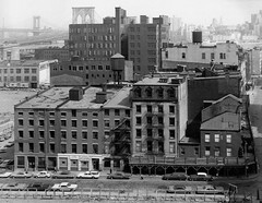 By the late 1960s, vast swaths of Lower Manhattan were gritty, abandoned relics of 19th century industry and housing. Looking to the Brooklyn Bridge from Gold Street in the foreground and Beekman Street at right. New York. 1967 (wavz13) Tags: industry vintagecar industrial antiquecar oldphotographs oldcar oldphotos oldcars oldnewyork vintagecars vintagephotos antiquecars oldbridge oldfactory vintagephotographs oldindustry industrialage 1950scar 1950scars oldbrooklyn oldfactories oldbridges antiquebridge vintagenewyork 1960scars vintagefactory 1958impala 1960scar 1960sphotos oldmanhattan vintagebridge 19thcenturyindustry vintageindustry 1960sphotography vintagemanhattan vintagebridges vintagebrooklyn antiquenewyork 1960snewyork vintagefactories antiqueindustry 1960sphotographs antiquebridges 1960sbrooklyn 1960smanhtattan 196364riviera