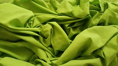 Green sheets in the morning (marcus gordianus) Tags: bedding sheets color colour green greener bedsheets wrinkled abstract closeup creases
