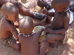 Children With Pot of Porridge, Otjikandero Himba Village, Kunene, Namibia (HDR) (dannymfoster) Tags: africa namibia otjikandero himbavillage otjikanderohimbavillage people africanpeople himba children himbachildren
